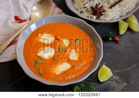Paneer Butter masala and cooked rice Indian Curry vegetarian Dinner