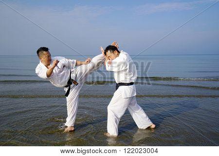 KAGAWA, JAPAN - Jan 3: Japanese karate men training of karate fighting in midwinter of a new year at Ichinomiya Beach, January 3, 2016, Kagawa, Japan
