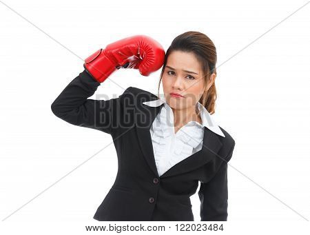 Asian business woman hitting herself with boxing gloves isolated on white background