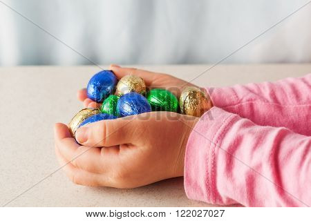 Child's Hands Holding Chocolate Easter Eggs