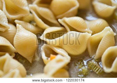 macro shot of pasta in a pot with soup