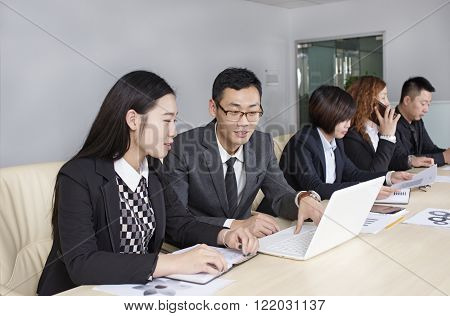 Group of people working at the desk