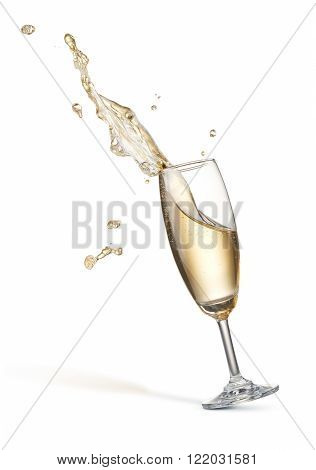 glass of splashing champagne isolated on white