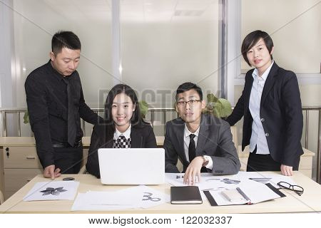 Business group  in a meeting smiling at the camera