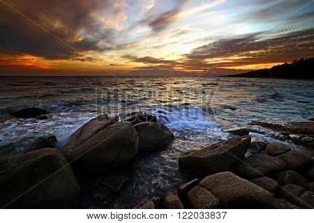 Sunset Over The Sea Mist On Rocks