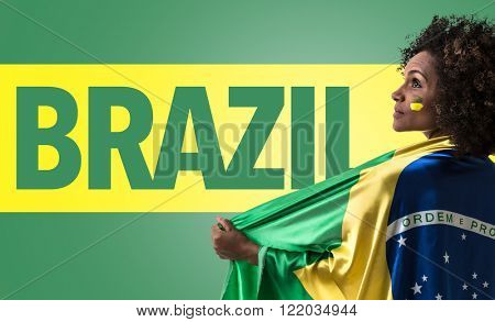 Brazilian woman holding the flag of Brazil and the Text: Brazil