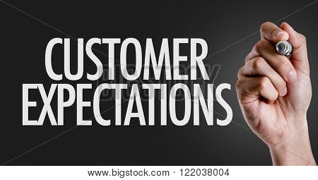 Hand writing the text: Customer Expectations