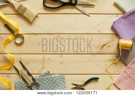 Sewing materials on wooden board.