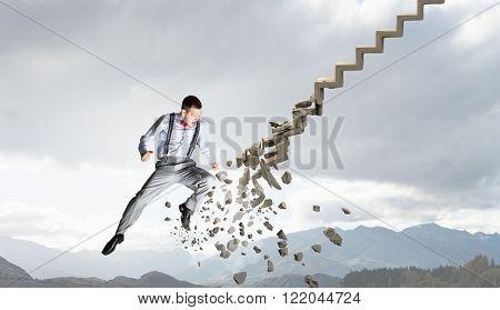 Man breaking ladder