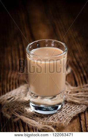 Irish Cream Liqueur (detailed close-up shot) on wooden background