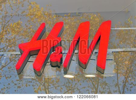 BARCELONA SPAIN - DECEMBER 9: Logo of H&M flagship store in the street of Barcelona on December 9 2014. H&M is a world famous fashion brand founded in Sweden.
