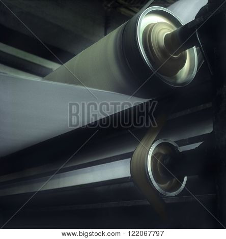 Medium format film photography shot. Paper reel rolling at a paper machine.