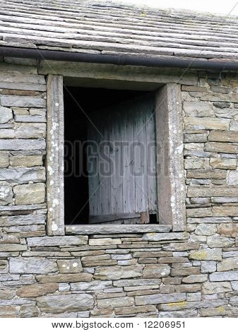 Window in abandoned farm building in Hawes, Yorkshire Dales, UK.