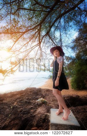 Young Asia woman standing at beach , Portrait and beach travel concept.