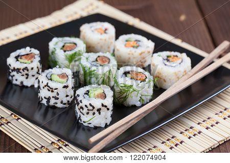 Uramaki sushi set on a plate. Shallow dof
