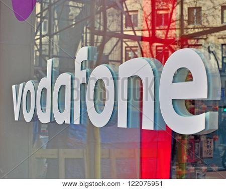 BARCELONA SPAIN - FEBRUARY 5: Logo of Vodafone company in the street of Barcelona February 5 2014. Vodafone is an international telecommunication company.