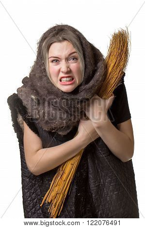 Angry woman in a scarf with a broom in his hand on white background