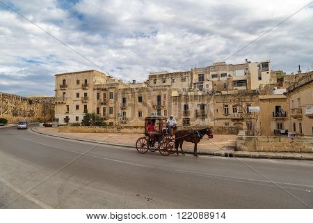 VALLETTA MALTA - OCTOBER 30 2015 : General view of Valletta cityscape at Malta island with historical limestone buildings from medieval times.