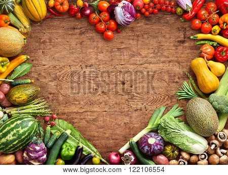 Heart shaped food. Food photography of heart made from different fruits and vegetables on rustic wooden table. Copy space. High resolution product