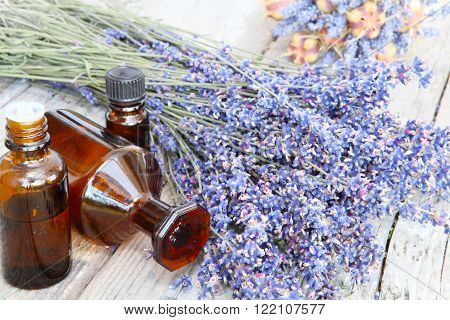 lavender with medicine bottles on old garden table