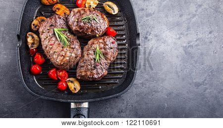 Steak. Grill beef steak. Portions thick beef juicy sirloin steaks on grill pan or old wooden board. ** Note: Shallow depth of field