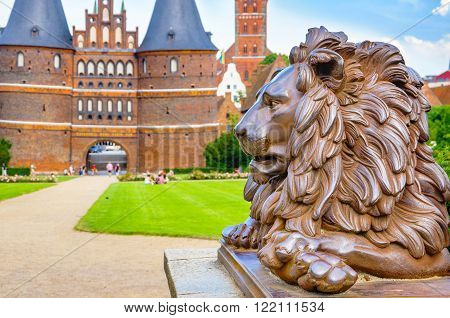 Lion statue beside Holstein Gate at Lubeck. Schleswig Holstein Germany