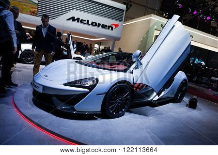 Geneva, Switzerland - March 1, 2016: McLaren 570GT, front-side view presented on the 86th Geneva Motor Show in the PalExpo