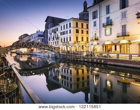 Bridge across the Naviglio Grande canal at the evening in Milan, Italy poster