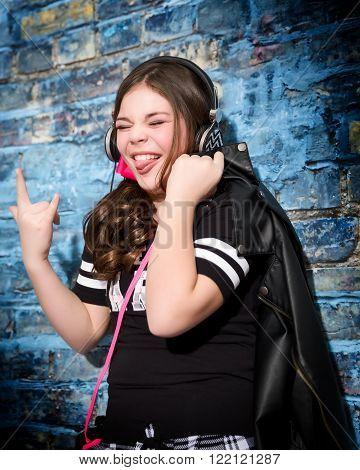 Cute fun and stylish caucasian tween girl listening to music