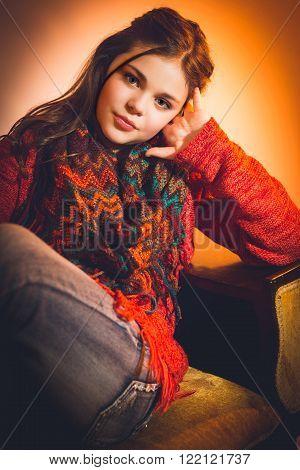 Cute fun and stylish caucasian tween girl sitting posed