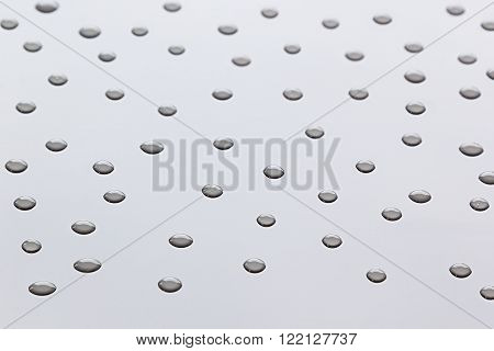The pattern of transparent water droplets on the light surface. Background.