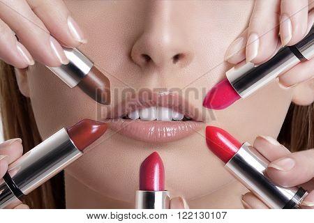 Beautiful Young Blond Model  Applying Lipstick