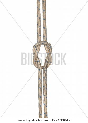 Decorative knot of thick cord isolated on white background.
