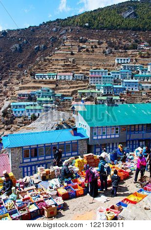 NAMCHE BAZARNEPAL-MARCH 7: Traditional Saturday market in Namche Bazar on March 7 2014 Khumbu district Himalayas Nepal