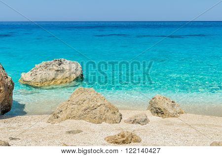 Megali Petra Beach, Lefkada Island, Greece. A beautiful beach with large rocks in the water.