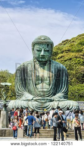 KAMAKURA, JAPAN - MAY 05, 2012 : Daibutsu - Peaople near famous Great Buddha  statue on the grounds of Kotokuin Temple in Kamakura, Japan