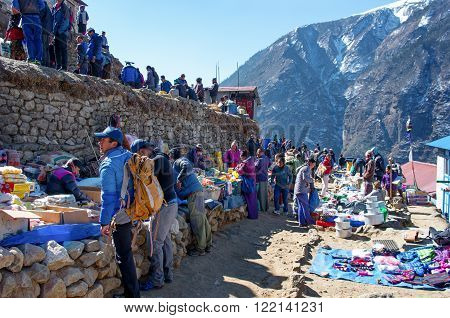NAMCHE BAZARNEPAL-MARCH 7: Traditional Saturday market in Namche Bazar on March 7, 2014 Khumbu district Himalayas Nepal