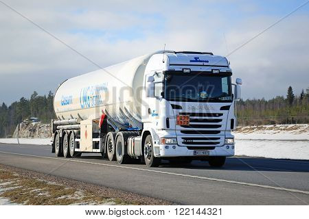PAIMIO FINLAND - MARCH 12 2016: Scania semi tank truck in ADR haul along motorway. The ADR code 223 1972 signifies methane refrigerated liquid or natural gas with high methane content.