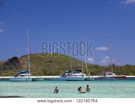 MAURITIUS - APRIL 24, 2012: catamarans about Gabrielle's island. Tourists swim in the sea on April 24 2012 in Mauritius.