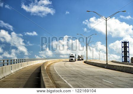 View on highway road with two transit lorry street lamps outdoor sunny weather on cloudy blue sky background horizontal picture