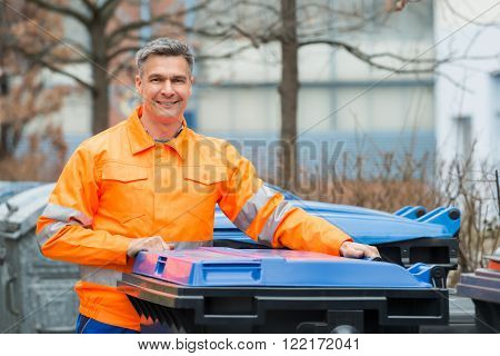 Working Man Standing Near Dustbin On Street