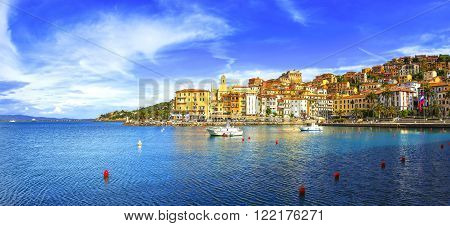 Porto Santo Stefano harbor seafront and village skyline italian travel destination. Monte Argentario Tuscany Italy.
