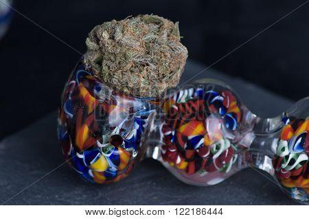 Grandaddy Purple Medical Medicinal Marijuana in colorful pipe