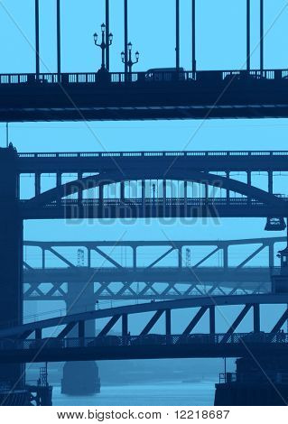 Telephoto view of Newcastle/Gateshead bridges with blue color added.