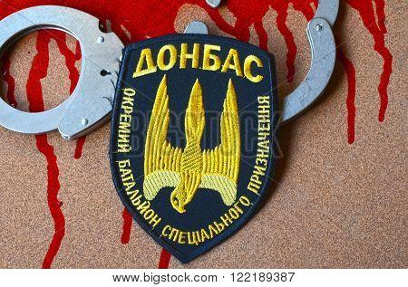 Chevron Ukrainian nazionalist chastener battalion Tornado in Police.The battalion disbanded for looting,rape and torture February 20,2016 in Kiev, Ukraine
