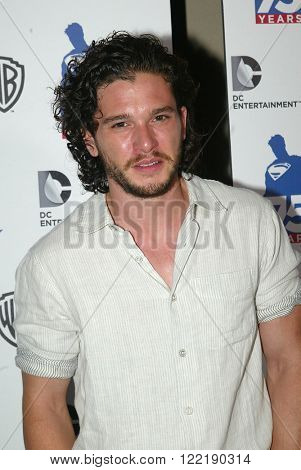Kit Harington arrives at the DC Entertainment and Warner Bros.Superman 75th anniversary party during San Diego Comic-Con at the Hard Rock Hotel San Diego's Float Bar, July 19, 2013 in San Diego, CA.