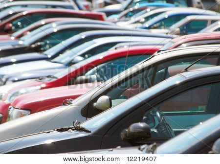 Long telephoto view of cars in parking lot