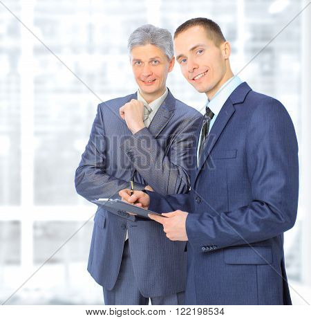 Two businessmen conclude a deal in the office