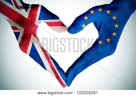 the hands of a young woman patterned with the flag of the United Kingdom and the European Community forming a heart, with a vignette added