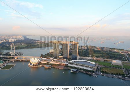 Singapore, Singapore - May 18, 2015: Marina Bay Sands hotel, ArtScience museum and Singapore Flyer. The hotel is a luxury resort famous for its infinity swimming pool. The Singapore Flyer is one of the worlds tallest Ferris wheels.